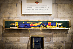 © Licensed to London News Pictures. 14/03/2017. York UK. The Normandy Veterans branch standard in it's final resting place at York Minster this morning. The last four members of the York branch of the Normandy Veterans Association have attended a service today at York minster as part of a special memorial to lay-up their standard in it's final resting place in the minster & to all who served in the Normandy campaign in 1944. The standard has been placed in it's case in the North Transept of the minster by Kenneth Smith who was part of the Duke of Cornwall's Light Infantry and landed in Normandy on D-Day June 1944 aged just 19 years old. Mr Smith was joined by the remaining three members of the York branch - Ken Cooke, 91, Albert Barritt, 91 and George Meredith, 92 - and their families for the service. All four veterans were awarded the Legion d'Honneur, France's highest military honour, in May 2016. Photo credit: Andrew McCaren/LNP