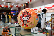 2008 Olympic Games official Fuwa mascot puzzle ball in souvenir shop, Wangfujing Street, Beijing, China