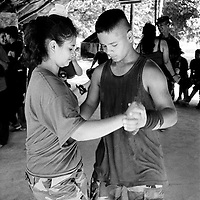 Young FARC recruits dance together at a New Year party held in their camp.<br />