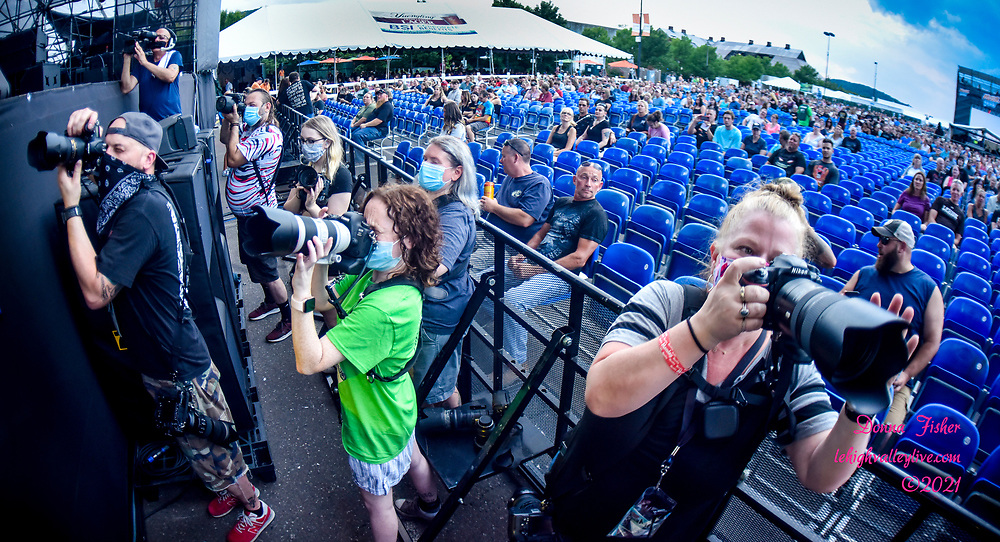 Photographers work in the pit area of the Wind Creek Steel Stage. Musikfest, a festival of ArtsQuest, is held August 6 –15, 2021 in Bethlehem, Pa..