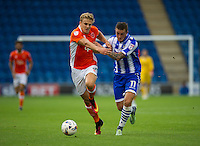 Colchester United's Ben Dickenson holds off the challenge from Blackpool's Brad Potts<br /> <br /> Photographer Ashley Western/CameraSport<br /> <br /> The EFL Sky Bet League Two - Colchester United v Blackpool - Saturday 10th September 2016 - Colchester Community Stadium - Colchester<br /> <br /> World Copyright © 2016 CameraSport. All rights reserved. 43 Linden Ave. Countesthorpe. Leicester. England. LE8 5PG - Tel: +44 (0) 116 277 4147 - admin@camerasport.com - www.camerasport.com