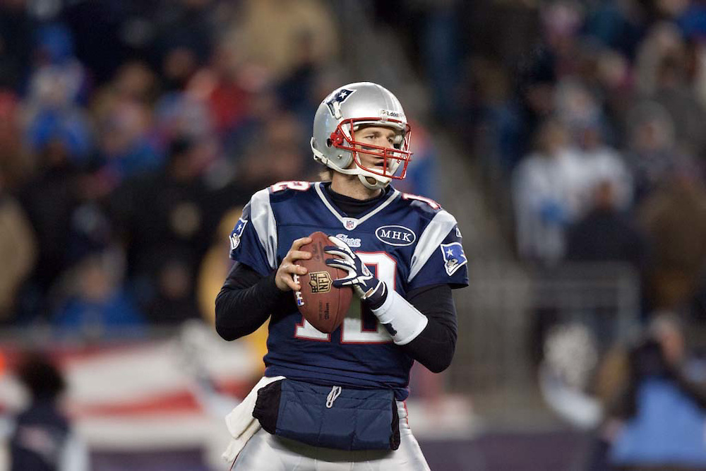 Foxborough, MA 01/14/2012.Patriots quarterback Tom Brady looks to pass in the second half of Saturday's AFC Divisional game between the New England Patriots and the Denver Broncos..Wicked Local Photo by Alex Jones