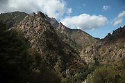 Landscape view from the town of Evisa on 14th September 2017 in Corsica, France. Evisa is a central location for walkers who come to walk to the Gorges de Spelunca which are below in the distance. Corsica is an island in the Mediterranean and one of the 18 regions of France. It is located southeast of the French mainland and west of the Italian Peninsula.