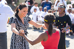 File photo dated23/09/19 of the Duchess of Sussex joining in with dancers as she leaves the Nyanga Township in Cape Town, South Africa, as the PA news agency looks back on the royal couple's year.