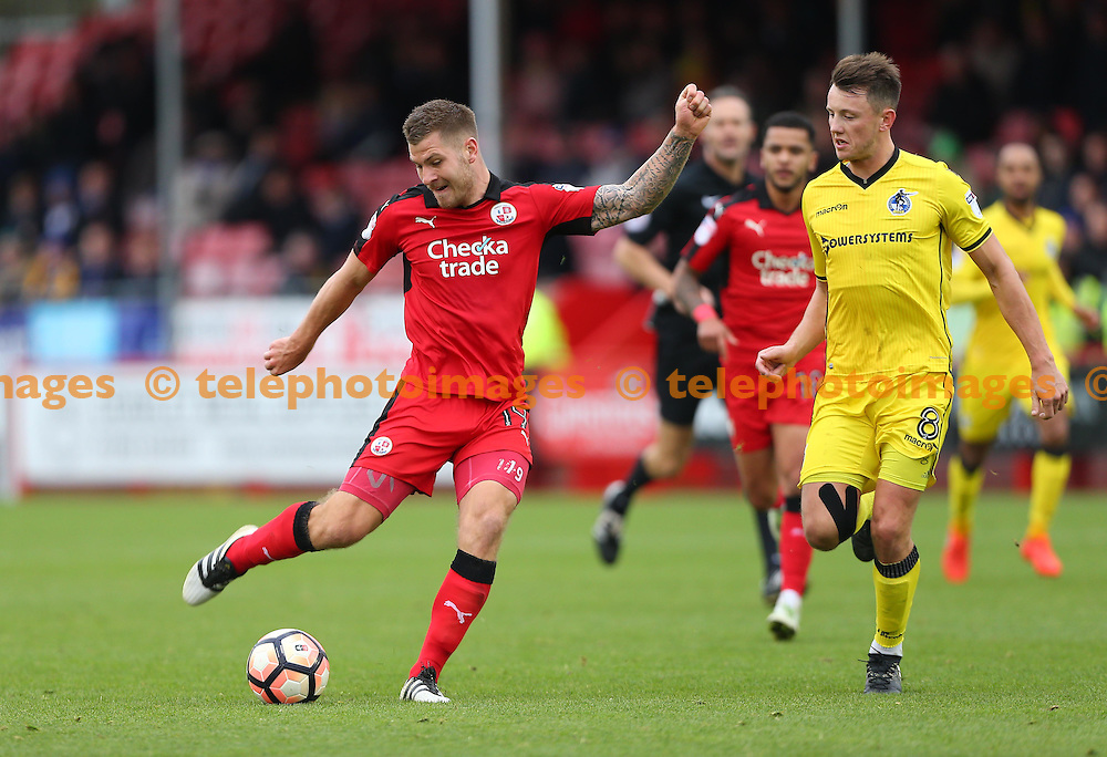 Crawley's James Collins shoots during the FA Cup match between Crawley Town and Bristol Rovers at the Checkatrade Stadium in Crawley. November 5, 2016.<br /> James Boardman / Telephoto Images<br /> +44 7967 642437