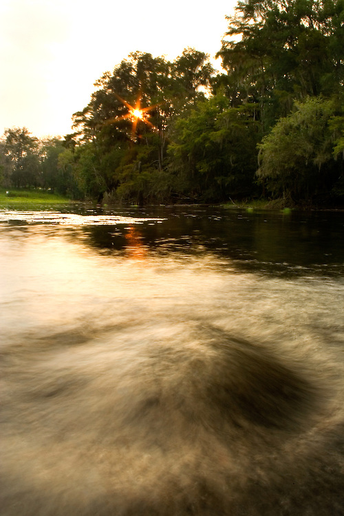 A random spring boil gushes water into the Santa Fe River. The Santa Fe is a relatively unaltered watershed in North Florida that is now threatened by agricultural and residential pollution, and water bottling interests.