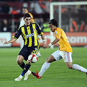 Galatasaray's Giovani Dos Santos Ramirez (R) and Fenerbahce's Ozer HURMACI (L) during their Turkish superleague soccer derby match Galatasaray between Fenerbahce at the AliSamiYen Stadium at Mecidiyekoy in Istanbul Turkey on Sunday, 28 March 2010. Photo by TURKPIX