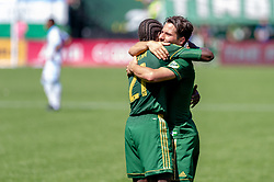 May 13, 2018 - Portland, OR, U.S. - PORTLAND, OR - MAY 13: Portland Timber midfielders Sebastián Blanco and Diego Chara celebrate Blanco's goal during the final minutes of the Portland Timbers 1-0 victory over the Seattle Sounders on May 13, 2018, at Providence Park in Portland, OR. (Photo by Diego Diaz/Icon Sportswire) (Credit Image: © Diego Diaz/Icon SMI via ZUMA Press)