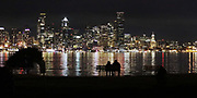 A clear night provides a good view of the lights of the Seattle skyline from the Don Armeni Boat Ramp in West Seattle along Harbor Avenue Southwest. (Alan Berner / The Seattle Times)