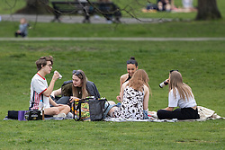 © Licensed to London News Pictures. 31/03/2021. London, UK. Members of the public picnic and enjoy the warm weather in Greenwich Park in South East London. Temperatures are expected to rise with highs of 22 degrees forecasted for parts of London and South East England today . Photo credit: George Cracknell Wright/LNP