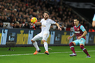 Angel Rangel of Swansea city (l) shields the ball from Mauro Zarate of West Ham Utd. Barclays Premier league match, Swansea city v West Ham Utd at the Liberty Stadium in Swansea, South Wales  on Sunday 20th December 2015.<br /> pic by  Andrew Orchard, Andrew Orchard sports photography.