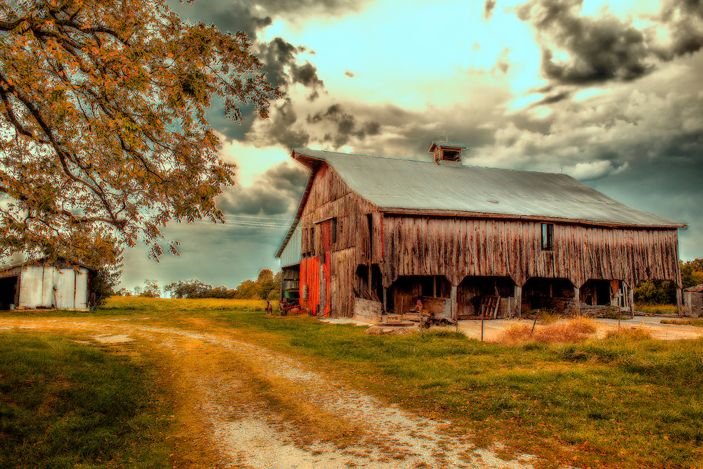Taken near Marthasville, Missouri this Old Dilapidated Barn was just begging to be photographed. I love old barn shots, something very calming to me about them for some reason.<br /> <br /> Marthasville is located near the site of the early 1763 French fur trading post named La Charrette. It was founded by Dr. John Young in 1817 and named after his first wife Martha Fuqua.<br /> <br /> The Missouri, Kansas and Eastern Railroad was completed through Marthasville in the winter of 1892 and taken over by the Missouri, Kansas and Texas Railroad (MKT) in July of 1893.<br /> <br /> The area is also full of historical importance, both local and national. The Lewis and Clark Discovery Expedition overnighted here in 1804 on their way up the Missouri and again on the way home in September of 1806. Daniel Boone and his relatives lived in the area. He and Rebecca were buried on the Bryan farm. His gravesite is just one mile east of Marthasville.<br /> <br /> The region was widely settled by German immigrants during the 1800's who brought their wine making skills with them and were attracted to this Missouri River Valley which has become known as the Missouri Rhineland.<br /> <br /> Some of the many attractions in and around the area are; the KATY State Park Hiking and Biking Trail, the Lewis and Clark Trail, and the Daniel Boone Monument. You'll find the finest wineries tucked in along our scenic drives through the hills and along the Missouri River.