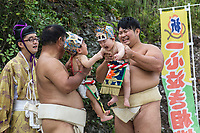 """On your mark, get set, now SCREAM!  Nakizumo is a 400 year old event that appears to be based on the proverb """"crying babies grow faster"""".   Babies less than 1 year old are brought to the shrine, flung into the air, screamed and made faces at by sumo wrestlers and Shinto priests (or gyoji sumo referees) usually two at a time.  Whichever baby screams first or loudest is declared the winner, though there is no real prize. At first this ritual may appear to be cruel, making babies cry, but it is all in good fun at least for the adults.  It is also believed that the ceremony, which involves purification before the crying part, will enable babies to grow up stronger and healthier, so it's all for the best.  The screaming sobs are also supposed to ward off evil spirits.   For good measure, both babies are hoisted high into the air by the wrestlers so that their screams will be closer to heaven, which will intensify the blessing."""