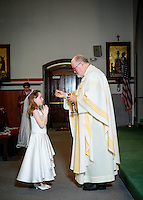 May 3, 2015 St Catherine of Siena First Communion celebration . Photographed by Dan Busler Photography 781-352-4863