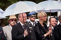 19.07.2015 Giby woj podlaskie Obchody 70. rocznicy Oblawy Augustowskiej - najwiekszej zbrodni w powojennej Polsce przy krzyzu w Gibach , ktory jest symbolicznym grobem ofiar . W lipcu 1945 roku Sowieci uprowadzili okolo 600 mieszkancow Augustowszczyzny , Sejnenszczyzny i Suwalszczyzny . Do tej pory nie wiadomo, gdzie znajduja sie ich groby . Sledztwo w tej sprawie trwa od 2001 roku . Akta licza juz ponad 70 tomow zas rozwiazaniem zagadki zajmuje sie zespol prokuratorow IPN , ktorzy przesluchali do tej pory ponad 700 swiadkow n/z (L-P) prezes IPN Lukasz Kaminski oraz Barbara Bojaryn-Kazberuk dyrektor bialostockiego oddzialu IPN fot Michal Kosc / AGENCJA WSCHOD