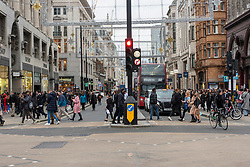 © Licensed to London News Pictures. 12/12/2020. London, UK. Christmas shoppers in Oxford Circus on a busy Saturday afternoon. London is currently under Tier 2 Covid restrictions and could be facing Tier 3 as the Covid-19 case rate has been the highest in the UK. Photo credit: Ray Tang/LNP