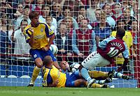 Photo: Richard Lane.Digitalsport<br /> Aston Villa v Southampton. Barclays Premiership. 14/08/2004.<br /> Darius Vassell fires the ball past Antti Niemi for a Villa goal.