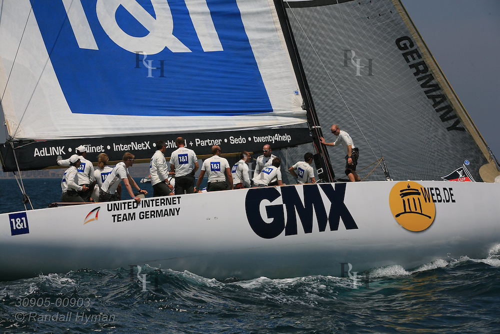 Germany's United Internet team relaxes between races during America's Cup fleet racing; Valencia, Spain.