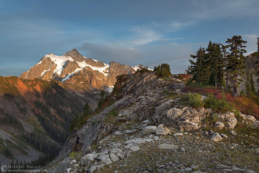 Sunset on Mount Shuksan from the Artist Point to Huntoon Point trail along Kulshan Ridge in Washington State's North Cascades Range. Photographed from Kulshan Ridge in the Mount Baker Wilderness. Mount Shuksan itself lies in North Cascades National Park.