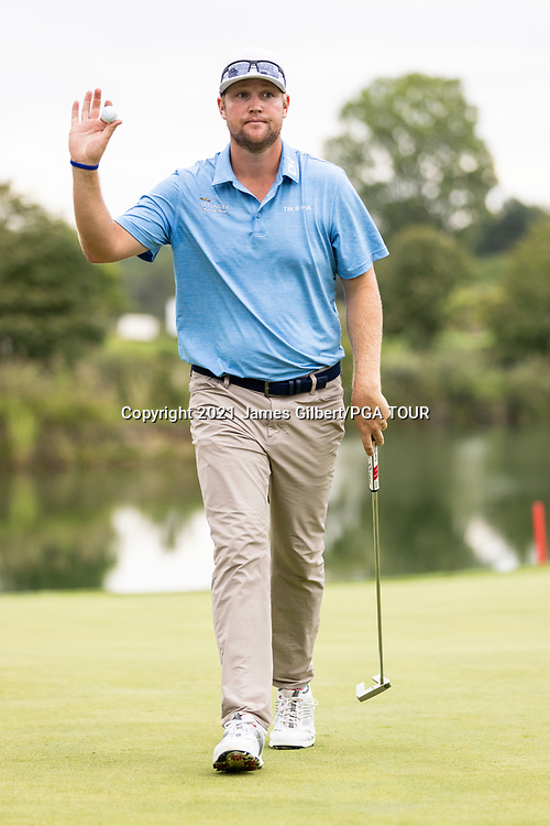 NEWBURGH, IN - SEPTEMBER 04: Trey Mullinax acknowledges the crowd after sinking his putt on the 18th green during the third round of the Korn Ferry Tour Championship presented by United Leasing and Financing at Victoria National Golf Club on September 4, 2021 in Newburgh, Indiana. (Photo by James Gilbert/PGA TOUR via Getty Images)