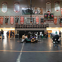 Miyamura Patriot Dominic Gutierrez wrestles Farmington Scorpion Xander Vincent Saturday at Gallup High School in Gallup at the Duel in the Dunes wrestling tournament.