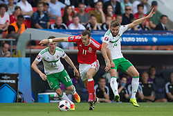 PARIS, FRANCE - Saturday, June 25, 2016: Wales' Gareth Bale in action against Northern Ireland's Lee Hodson and Stuart Dallas during the Round of 16 UEFA Euro 2016 Championship match at the Parc des Princes. (Pic by Paul Greenwood/Propaganda)