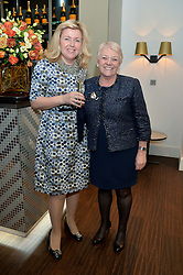 Left to right, ROSALEEN BLAIR and DIANNE THOMPSON at a dinner in honour of Veuve Clicquot Business Woman Award UK Previous Winners held at Moet Hennessy, 18 Grosvenor Gardens, London on 8th April 2014.