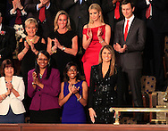 First Lady Melania Trump arrives at  a joint session of Congress on February 28, 2017.Ivanka Trump and Jared Kushner are behind  the First Lady<br /> <br /> Photo by Dennis Brack