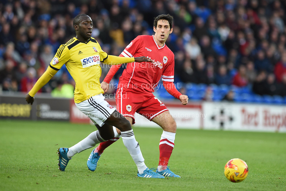 Toumani Diagouraga of Brentford (l) challenges Peter Whittingham of Cardiff city. Skybet football league championship match, Cardiff city v Brentford at the Cardiff city stadium in Cardiff, South Wales on Saturday 20th December 2014<br /> pic by Andrew Orchard, Andrew Orchard sports photography.