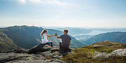 Drink stop on the hike between Fløyen and Ulriken mountains, Bergen, Norway. 19/05/14. Photo by Andrew Tallon