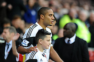 Swansea City Captain Ashley Williams walks out onto the field at the start of the game.<br /> Barclays Premier League match, Cardiff city v Swansea city at the Cardiff city stadium in Cardiff, South Wales on Sunday 3rd Nov 2013. pic by Phil Rees, Andrew Orchard sports photography,
