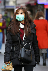 © Licensed to London News Pictures. 05/02/2020. London, UK. An Asian woman in central London wearing a face mask following the outbreak of Coronavirus in Wuhan, China. At least 427 people have died from the virus and there have been over 20,000 confirmed cases, most of them in China. Photo credit: Dinendra Haria/LNP