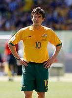 Photo: Glyn Thomas.<br />Australia v Japan. Group F, FIFA World Cup 2006. 12/06/2006.<br />Australia's Harry Kewell feels the heat.
