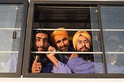 Construction workers on bus at end of working day in Dubai United Arab Emirates