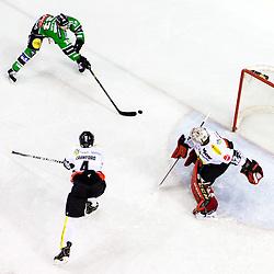 14.11.2014, Hala Tivoli, Ljubljana, SLO, EBEL, HDD Telemach Olimpija Ljubljana vs Dornbirner Eishockey Club, 18. Runde, in picture Jure Sotlar (HDD Telemach Olimpija, #33) scores a goal against Nathan Lawson (Dornbirner Eishockey Club, #52) during the Erste Bank Icehockey League 18. Round between HDD Telemach Olimpija Ljubljana and Dornbirner Eishockey Club at the Hala Tivoli, Ljubljana, Slovenia on 2014/11/14. Photo by Matic Klansek Velej / Sportida