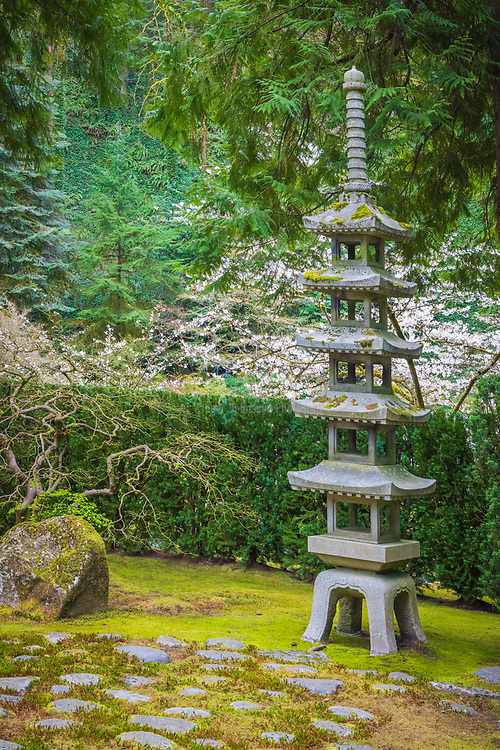 """The Portland Japanese Garden is a traditional Japanese garden occupying 12 acres, located within Washington Park in the West Hills of Portland, Oregon, United States. It is operated as a private non-profit organization, which leased the site from the city in the early 1960s. Stephen D. Bloom has been the chief executive officer of the Portland Japanese Garden since 2005. <br /> <br /> The Garden Pavilion was built in 1980 in Japanese style by local builders: it has a tiled roof, wooden verandas, and Shōji sliding doors. It is the center of several Japanese cultural festivals, art exhibitions, and other events. The west veranda faces the Flat Garden, and the east veranda overlooks downtown Portland and Mount Hood, which resembles Mount Fuji. Dozens of stone lanterns are present throughout the garden. The lower entrance features a 100-year-old temple gate, a 1976 gift of the Japanese Ancestral Society of Portland Oregon.<br /> <br /> As a Japanese garden, the desired effect is to realize a sense of peace, harmony, and tranquility and to experience the feeling of being a part of nature. Three of the essential elements used to create the garden are stone, the """"bones"""" of the landscape; water, the life-giving force; and plants, the tapestry of the four seasons. Japanese garden designers feel that good stone composition is one of the most important elements in creating a well-designed garden. Secondary elements include pagodas, stone lanterns, water basins, arbors, and bridges. Japanese gardens are asymmetrical in design and reflect nature in idealized form. Traditionally, human scale is maintained throughout so that one always feels part of the environment and not overpowered by it.<br /> <br /> The Japanese rock garden (枯山水 karesansui) or """"dry landscape"""" garden, often called a zen garden, creates a miniature stylized landscape through carefully composed arrangements of rocks, water features, moss, pruned trees and bushes, and uses gravel or sand that is raked to represen"""