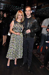 TRISH HALPIN editor of Marie Claire and actor JOSEPH MAWLE at a party to celebrate the launch of the Marie Claire Runway Magazine held at Le Baron a The Embassy, Old Burlington Street, London on 1st February 2012.