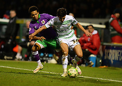Bristol City's Korey Smith battles for the ball with Yeovil Town's Liam Shepard - Photo mandatory by-line: Alex James/JMP - Mobile: 07966 386802 - 10/03/2015 - SPORT - Football - Yeovil - Huish Park - Yeovil Town v Bristol City - Sky Bet League One