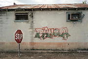 PANOLA, AL – OCTOBER 9, 2015: Graffiti on the side of the former Bank's General Store off of Highway 34. Due to state budget cuts, Alabama announced the closure of 31 of its driver's license offices in mostly rural sections of the state, where poverty is high and transportation is notoriously difficult. Critics argue the closures are an attempt to limit accessibility to photo IDs – which are now required for voting – but state officials insist that the closings have no effect on access to photo ID. CREDIT: Bob Miller for The New York Times