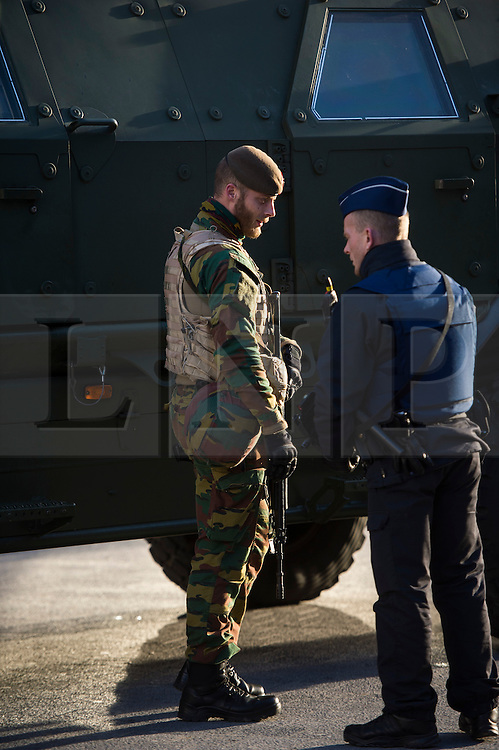 """© Licensed to London News Pictures. 23/11/2015. Brussels, Belgium. Belgian military patrolling Brussels Central Station  where the city is currently on """"lockdown"""" amid """"imminent threat"""" of Paris-style bomb and gun attacks. Photo credit: Ben Cawthra/LNP"""