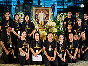 13 OCTOBER - BANGKOK, THAILAND: People gather around a portrait of the late King on the first anniversary of the death of Bhumibol Adulyadej, the Late King of Thailand. About 199 monks from 14 Buddhist temples in Bangkok participated in the mass merit making at Siriraj Hospital to mark the anniversary of the revered King's death. He will be cremated on 26 October 2017.  PHOTO BY JACK KURTZ