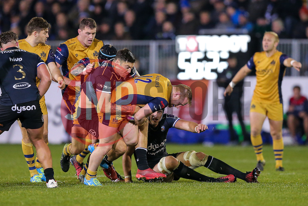 Will Hurrell of Bristol Rugby is tackled by Matt Banahan of Bath Rugby - Rogan Thomson/JMP - 20/10/2016 - RUGBY UNION - The Recreation Ground - Bath, England - Bath Rugby v Bristol Rugby - EPCR Challenge Cup.