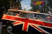 A VW camper van adorned with British union jack colours is parked on a campsite at Reedham on the Norfolk Broads. With late sun shining on its polished surfaces, we see a tent belonging to a camper at the site in East Anglia. Painted in the colours British flag, a theme of patriotic feeling by people summing up a great, traditional British summer and their love of the countryside. The Volkswagen Type 2, known officially, depending on body type as the Transporter, Kombi and Microbus, and informally as the Bus (US) or Camper (UK), is a panel van introduced in 1950 by German automaker Volkswagen as its second car model – following and initially deriving from Volkswagen's first model, the Type 1 (Beetle), it was given the factory designation Type 2.