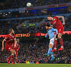 Aden Flint of Bristol City wins a header above Sergio Aguero of Manchester City - Mandatory by-line: Matt McNulty/JMP - 09/01/2018 - FOOTBALL - Etihad Stadium - Manchester, England - Manchester City v Bristol City - Carabao Cup Semi-Final First Leg
