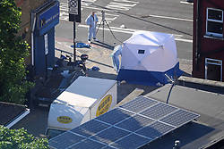 A forensic tent stands next to a van in Finsbury Park, north London, where one man has died, eight people taken to hospital and a person arrested after the vehicle struck pedestrians.