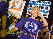 "23 JUNE 2012 - PHOENIX, AZ:   A member of the Unitarian ""witness team"" tries to control the crowd during a protest against the Maricopa County Jail system in Phoenix Saturday. About 2,000 members of the Unitarian Universalist Church, in Phoenix for their national convention, picketed the entrances to the Maricopa County Jail and ""Tent City"" Saturday night. They were opposed to the treatment of prisoners in the jail, many of whom are not convicted and are awaiting trial, and Maricopa County Sheriff Joe Arpaio's stand on illegal immigration. The protesters carried candles and sang hymns.    PHOTO BY JACK KURTZ"