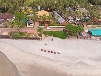 Aerial view of a road by the Ashwem beach in north goa, India.