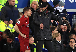 Liverpool manager Jurgen Klopp (right) speaks with James Milner during the Premier League match at Goodison Park, Liverpool.