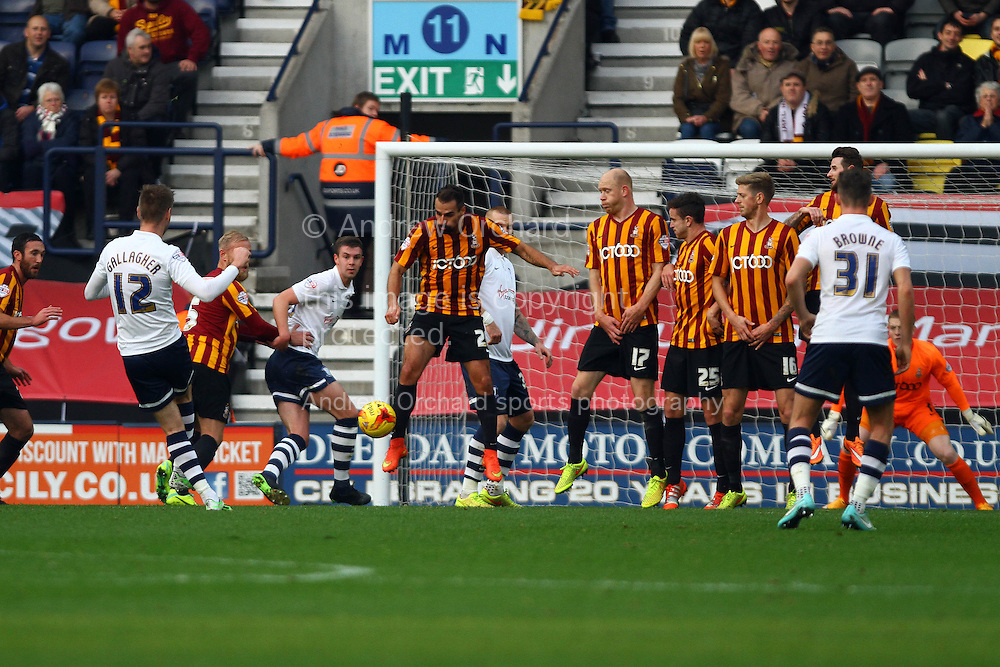 Preston North End's Paul Gallagher sees his effort at goal blocked. Skybet football league one match, Preston North End v Bradford city at Deepdale in Preston, Lancs on Saturday 15th November 2014.<br /> pic by Chris Stading, Andrew Orchard sports photography.