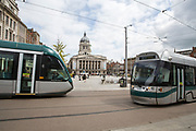 Nottingham Express Transit (NET) trams, travelling through Nottingham city centre outside Old Market Square, Nottingham, Nottinghamshire, United Kingdom. Trams run throughout the city to stop people using cars and encourage them to use more sustainable transport mechanisms.  (photo by Andrew Aitchison / In pictures via Getty Images)